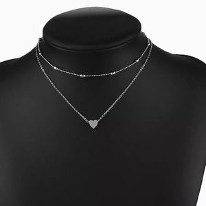 Multilayer chain necklace with heart silver tone